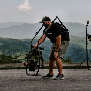 jonathan halley operating a camera on a ronin gimbal