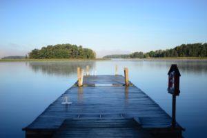 Photo of dock extending forward into a lake