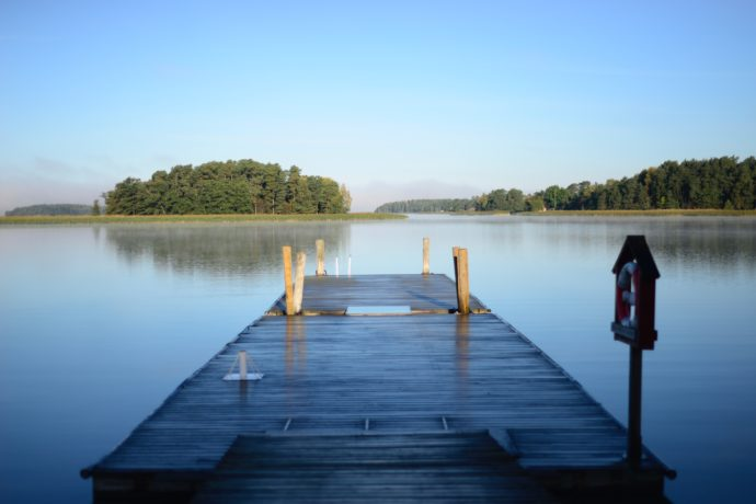 Photo of dock extending forward into a lake