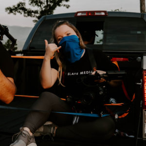 katelynn oltrogge sitting in the bed of a truck with a Sony Fs7