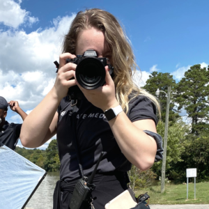 katelynn oltrogge holding a camera in front of her face