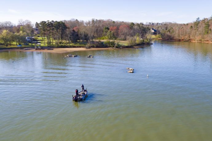 Drone shot of bass boat in the lake at the 2019 Bassmaster Classic