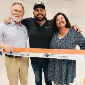 Mike, Jonathan, and Linda Halley at the Big Slate Media ribbon cutting