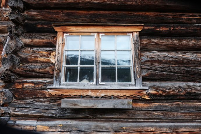 Window on the side of a rustic cabin