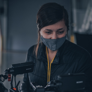 carrie hulsey on set operating a sony fs7 camera