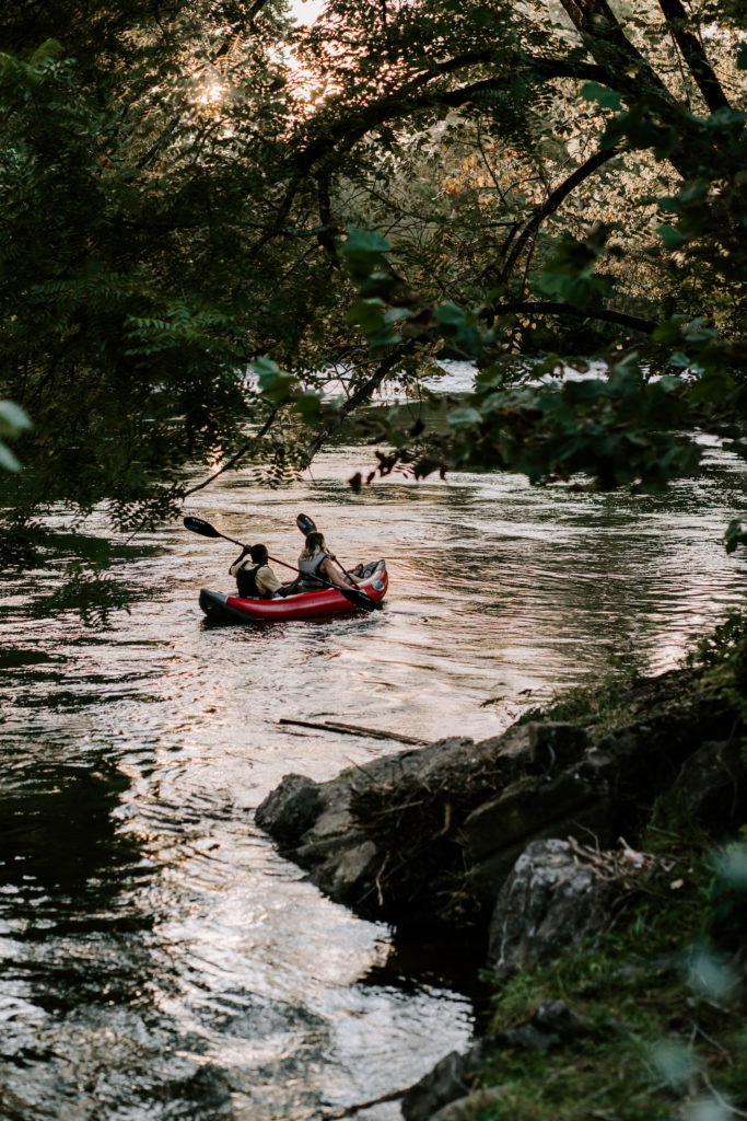two people kayaking on the little river