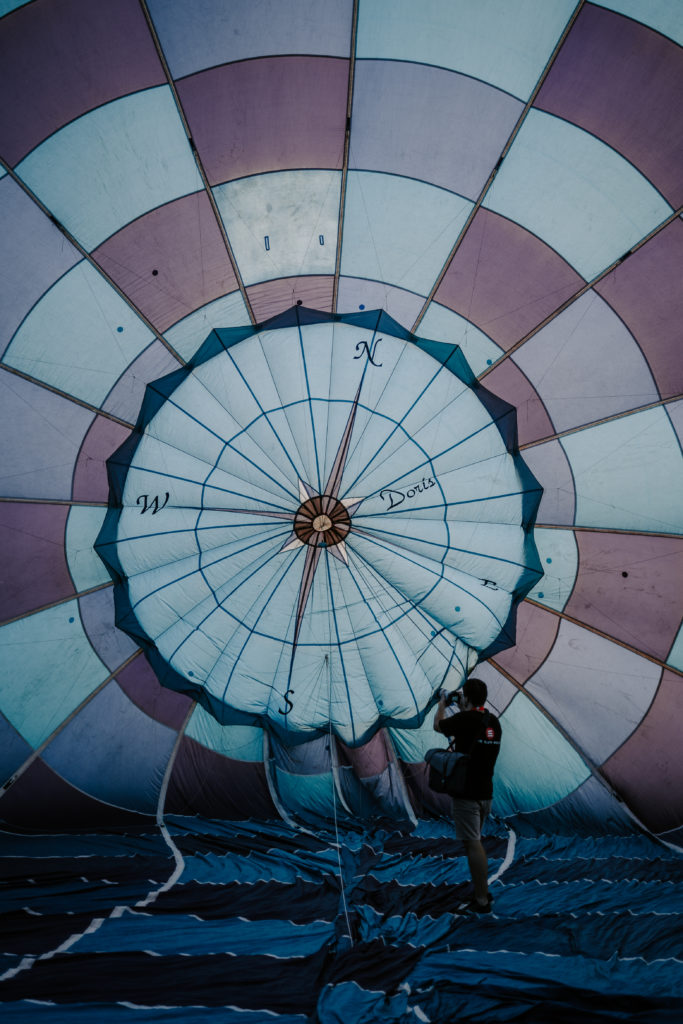 Eli Heaton pointing a camera at the inside of a hot air balloon