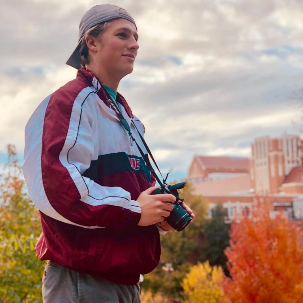Ben Gleason holding a camera